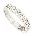 Bold organic filigree covers three quarters of the face of this antique style wedding band
