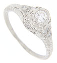 This antique style platinum engagement ring is studded with diamonds