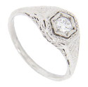 This beautiful platinum engagement ring has detailed filigree and delicate engraving on the antique style mounting