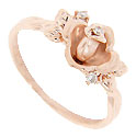 This 14K rose gold modern engagement ring is crafted in the shape of a rose