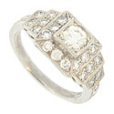 Terraced rows of diamonds adorn this antique style platinum engagement ring