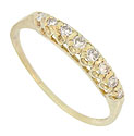 This floral inspired 14K yellow gold wedding band is set with a line of eight radiant diamonds