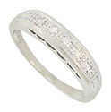 This classic 14K white gold wedding band is frosted with a row of glittering round diamonds