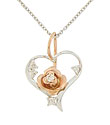 A handsome 14K red gold bloom set with a single faceted diamond is the focus of this romantic necklace