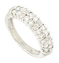 Dazzling round cut diamonds adorn the face of this 14K white gold wedding band