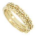 These 14K yellow gold stackable wedding bands feature a flowing design done in relief