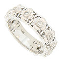 Large diamond set blossoms dance across the face of this 14K white gold wedding band