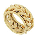 Two twisting braids of polished 14K yellow gold encircle the face of this unique vintage wedding band