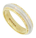 This elegant estate wedding band is a crafted of 18K yellow gold and platinum