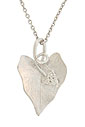 A glittering 14K white gold grape leaf wraps around a delicate chain on this antique style necklace