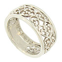 A bold curling filigree covers the face of this 14K white gold wedding band