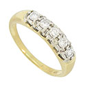 This exceptional 14K yellow gold estate wedding band is set .30 carat total weight of dazzling round faceted diamonds