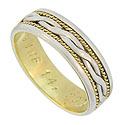 This handsome mens estate wedding band is handmade and crafted of platinum and 18K yellow gold