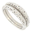 A bold woven organic filigree covers the face of these 14K white gold wedding bands