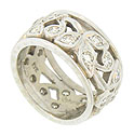 This 14K white gold antique diamond wedding band features a bold open floral cutwork set with sparkling fine faceted diamonds