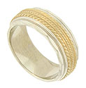 A triple strand of twisted 14K yellow gold presses into the white gold face of this estate wedding band