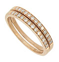 These glistening 14K red gold stackable wedding bands are channel set with dazzling round cut diamonds