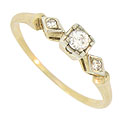 This elegant 14K yellow gold vintage engagement ring features an abstract floral design