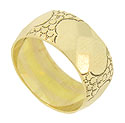 This wide 14K yellow gold estate wedding band is embellished with four large, faceted gold blooms