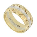 This distinctive 14K bi-color estate wedding band is adorned with golden abstract leaves and white gold latticework