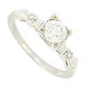A brilliant .54 carat, H color, I1 clarity round cut diamond glows from the face of this vintage engagement ring