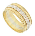This elegant 14K bi-color estate wedding band features a white gold ribbon of engraved florals