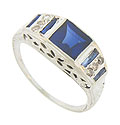 This antique 14K white gold ring is set with a square synthetic sapphire