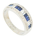 A dazzling band of diamond and sapphire baguettes press into the face of this spectacular 18K white gold wedding band