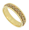 Distinctive 14K yellow, red and white gold twisting ropes weave together in a intricate braid to adorn the center of this Estate wedding band