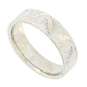 This elegant 14K white gold mens wedding band is adorned with curling jewel engraved ferns and leaves