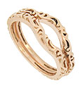 These 14K red gold curved wedding bands feature a flowing polished design worked in relief