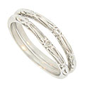 A bold cut work floral design decorates these 14K white gold curved wedding band brackets