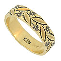 A riot of engraved leaves and flowers dance across the surface of this 14K yellow gold estate ring