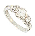 A luminous .33 carat round faceted diamond sparkles from the center of this 14K white gold engagement ring