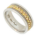 This handsome platinum estate wedding band is adorned with a braid of 18K yellow, red and white gold