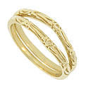 A bold cut work floral design decorates these 14K yellow gold curved wedding band brackets