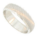 Fashioned of 14K white gold, this handsome wedding band is engraved with finely etched vertical lines