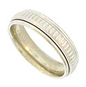 This antique style mens wedding band is fashioned of 14K white gold and decorated with a ribbon of vertical engraving