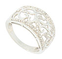 Open floral filgree designs frosted with fine faceted diamonds embellish the face of this antique style wedding band