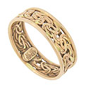 Intricately woven strands of 14K red gold encircle the face of this unique estate wedding band