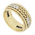 This phenomenal 14K yellow gold estate wedding band is adorned with a bold twisting braid and edged in distinctive milgrain decoration
