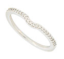 This 14K white gold curved wedding band is set with a string of fine faceted diamonds