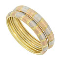 These unique 14K tri-colored stackable wedding bands feature a brushed surface of red, yellow and white stripes