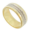 This distinctive 14K yellow gold estate wedding band is embellished with a simple braid of engraved white gold