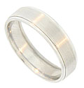 A ribbon of engraved ridges encircles the face of this 14K white gold mens wedding band