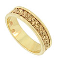 A handsome braid of twisting 14K yellow gold encircles this elegant estate wedding band