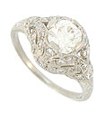 This spectacular antique style platinum engagement ring is set with a dazzling EGL certified 1.07 carat, H color, Si2 carat round cut diamond