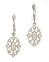 These 14K white gold antique style earrings feature a crystal shape and are decorated with diamond cut engraving