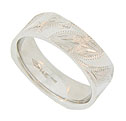 A surface of polished curving horn shapes swoop in from the edges of this handcrafted 14K white gold mens wedding band