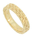 This sparkling 14K yellow gold wedding band is embellished with deeply engraved scalloped and swirl designs